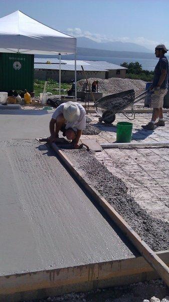 Bill working screeding the concrete