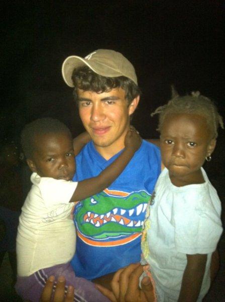 Chevo with two village children