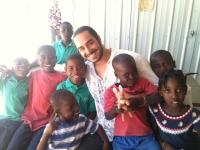 Brett M. with some of Yvrose's children