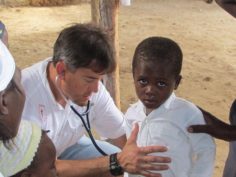 Dr. Chris Konsavage examining a child