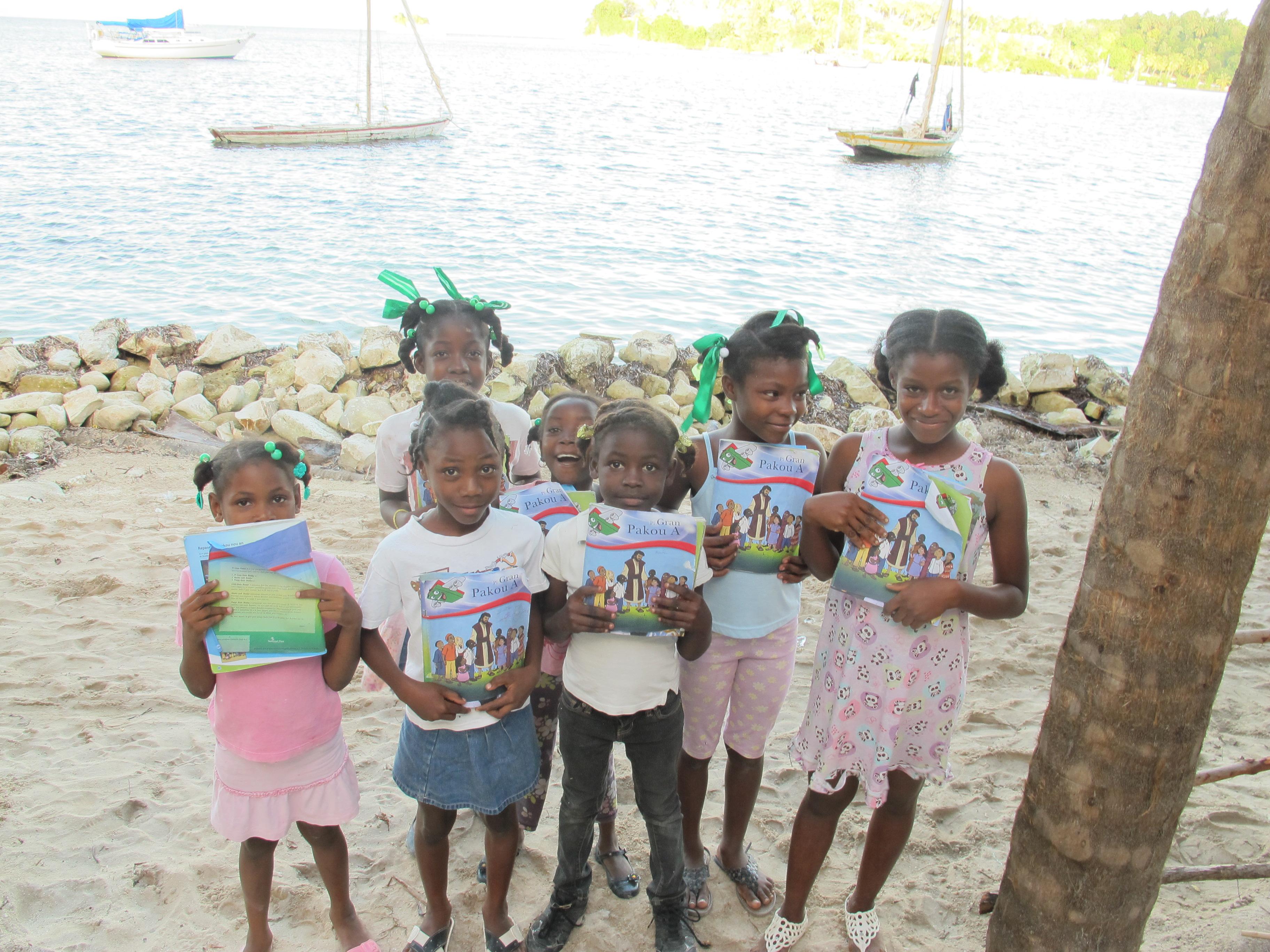 Children showing us their Greatest Journey books