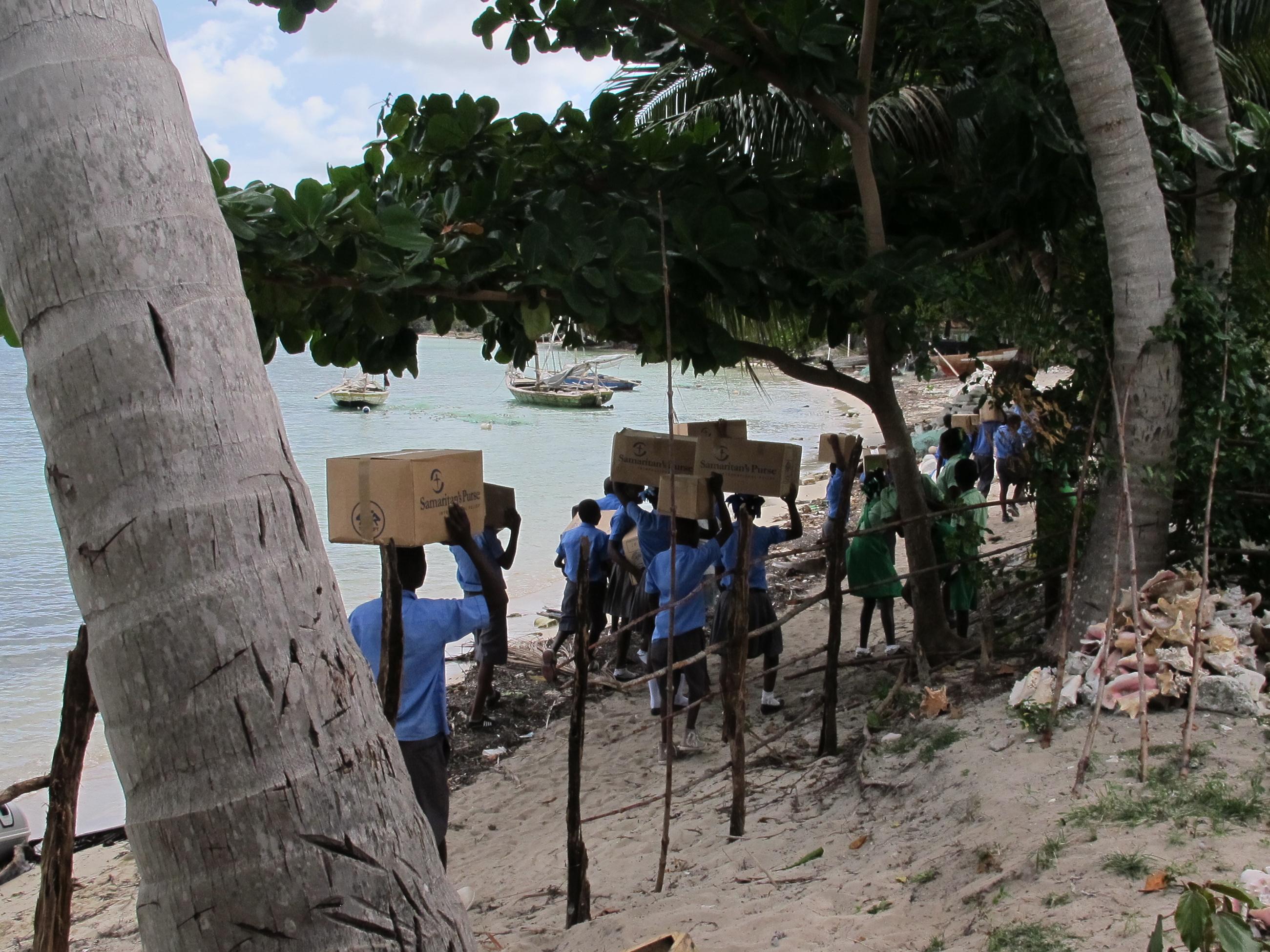Children taking OCC gifts to their school