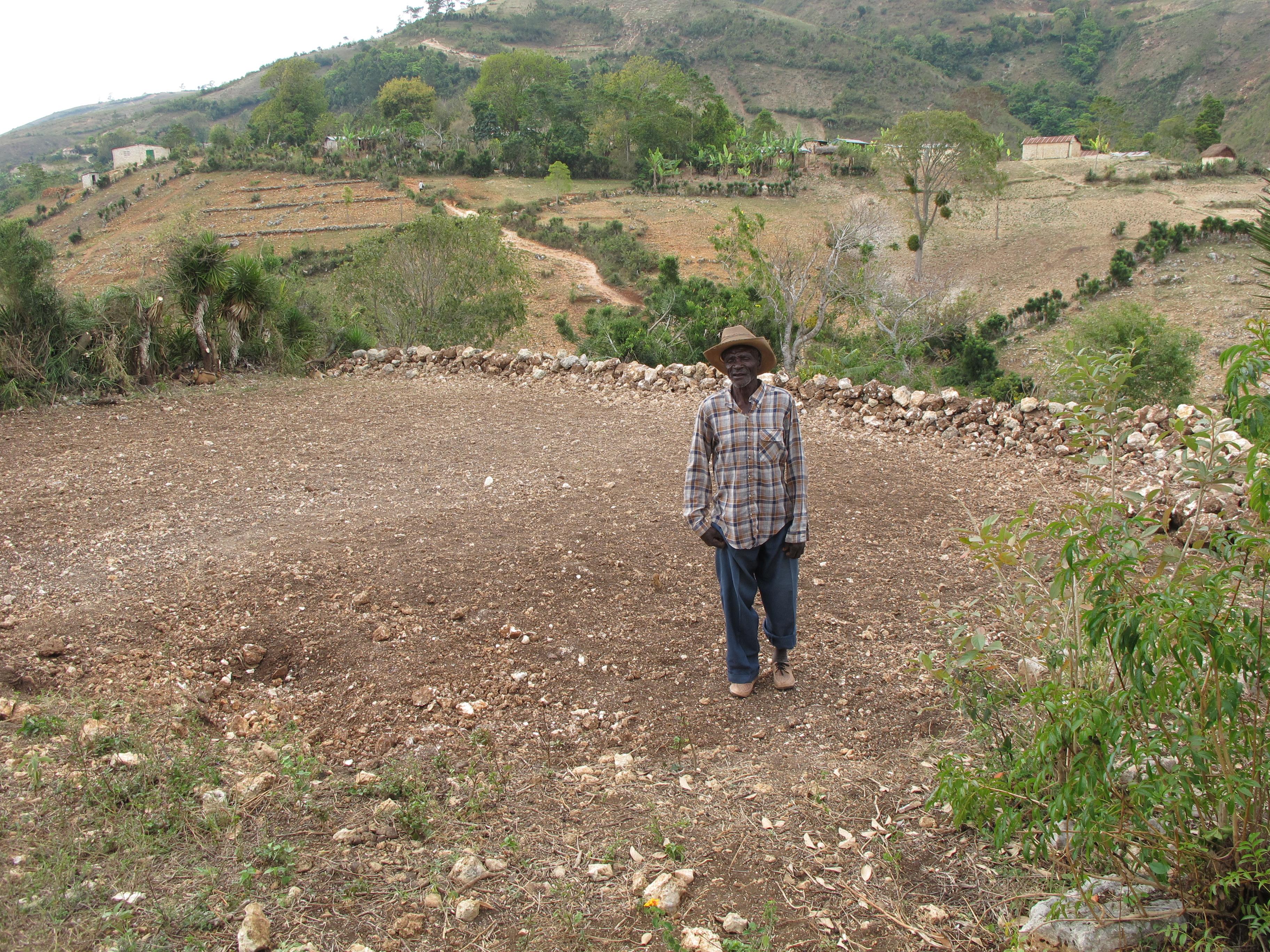 Poppy standing on land in Pelerin he hopes a church will be built on.