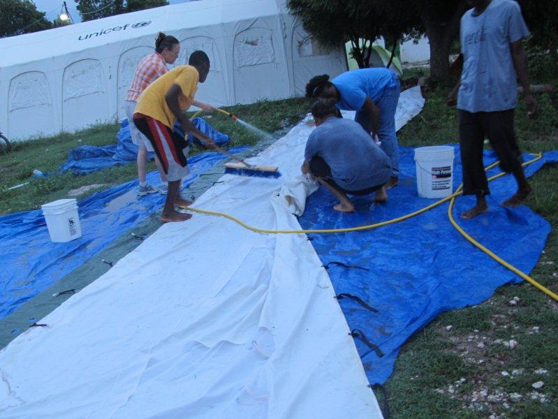 Washing up the 1st donated cholera tent.