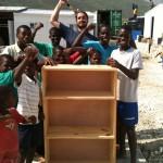 Brett after teaching Yvrose's boys to build a shelf unit